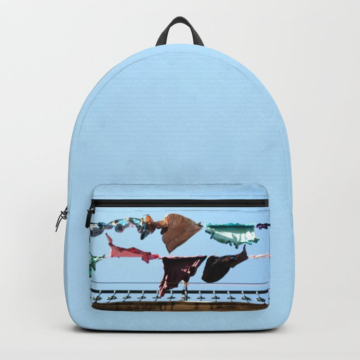 Hanging laundry in blowing wind Backpack