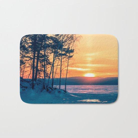 Winter sunset and the sun pillar Bath Mat