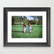 Girls in field Framed Art Print