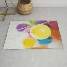 Bunch of pastel colored balloons flying in the air Rug