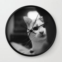 Cat peeking over owner's shoulder - black & white Wall Clock