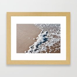 Foam on the beach on the Sunshine Coast Framed Art Print