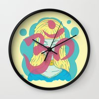 om Wall Clocks featuring Om by Monstruonauta