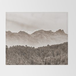 The mountain beyond the forest Throw Blanket