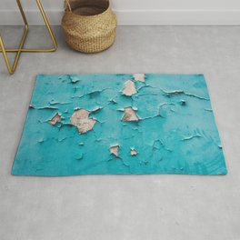 Blue weathered cement wall with cracked and grunge texture Rug