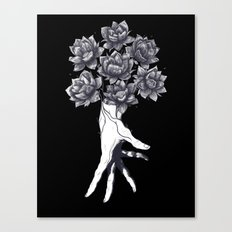 Hand with lotuses on black Canvas Print