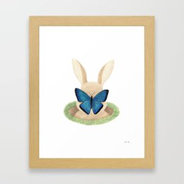 Butterfly resting on a bunny's nose Framed Art Print