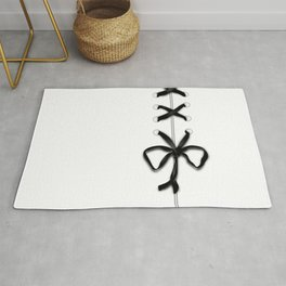 Laced Black Ribbon on White Rug
