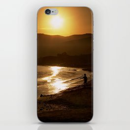 On the beach, at sunset iPhone Skin