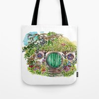 the hobbit Tote Bags featuring Hobbit hole by Kris-Tea Books