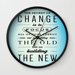 The Secret Of Change Is To Focus All Of Your Energy Inspiration Typography Quote Wall Clock