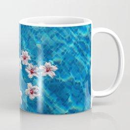 Almond blossom floating in swimming pool Coffee Mug