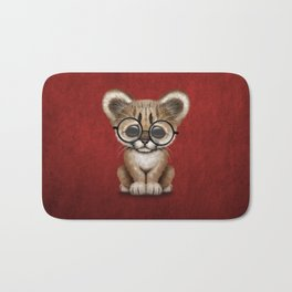Cute Cougar Cub Wearing Reading Glasses on Red Bath Mat