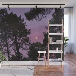 Moon through the trees. Into the woods at sunset Wall Mural