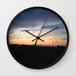 Wire Road sunset Wall Clock