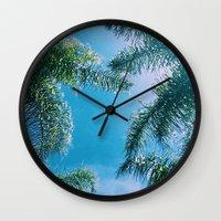 palm trees Wall Clocks featuring PALM TREES by C O R N E L L