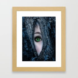 Big green eye in a blue tree Framed Art Print