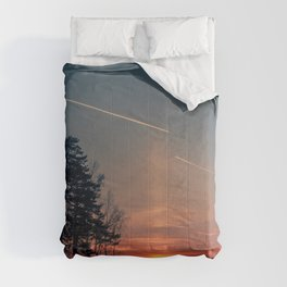 Flying at sunset Comforters