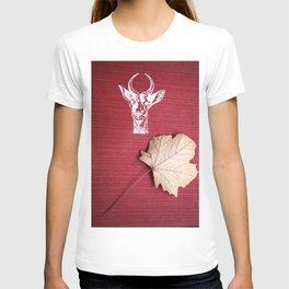 The red book, the dry leaf and the goat head T-shirt