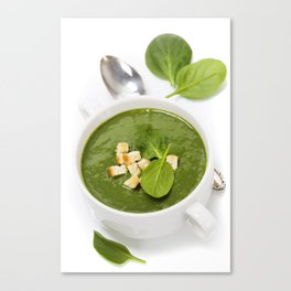 Traditional Spinach cream soup with croutons and fresh spinach leaf on top Canvas Print