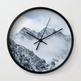 Mountains and clouds Wall Clock