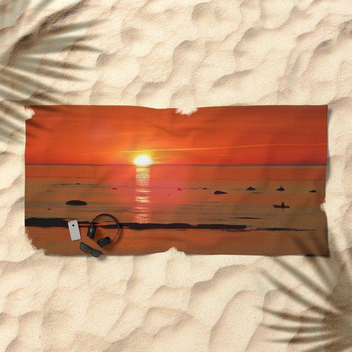 Kayaker and the Setting Sun Beach Towel