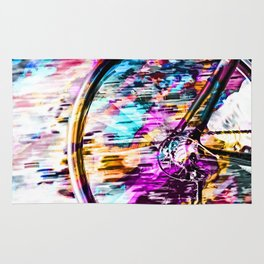 bicycle wheel with colorful abstract background in pink blue orange Rug