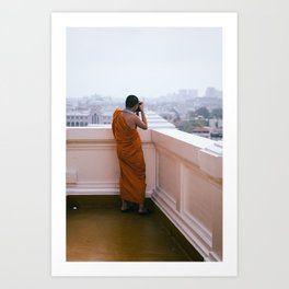 Buddhist monk taking pictures on top of temple in Bangkok, Thailand - Fine art wall art Art Print