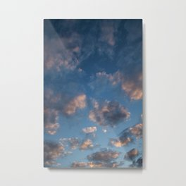 Blue sky with isolated clouds during sunset. Metal Print