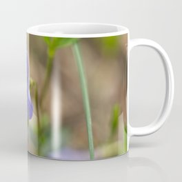 small blue flower in the forest Coffee Mug