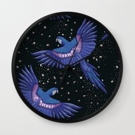 Hyacinth blue macaw parrots on the starry night sky Wall Clock