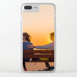Couple of lovers sit in a bench against sunset Clear iPhone Case
