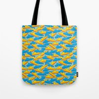 yellow submarine Tote Bags featuring Yellow & Blue Submarine by thunalab