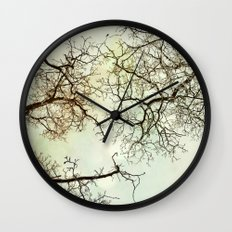 Winter tree branches in the sky Wall Clock