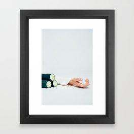 Hand next to cucumbers Framed Art Print