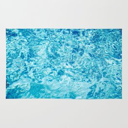 Crystal blue water creating an abstract pattern with waves and ripples Rug