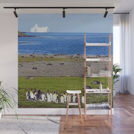 King Penguins on the beach with an Iceberg behind Wall Mural
