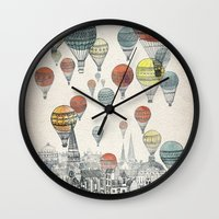 red hood Wall Clocks featuring Voyages over Edinburgh by David Fleck