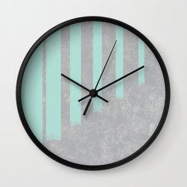 Soft cyan stripes on concrete Wall Clock