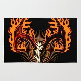 Deer skull on fire Rug