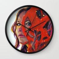 katniss Wall Clocks featuring Katniss by Alina Rubanenko