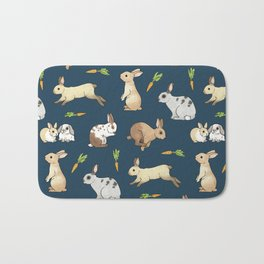 Rabbits on navy background Bath Mat