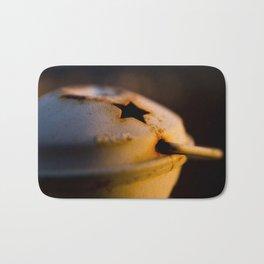 Candlestick at sunset Bath Mat
