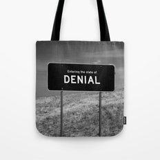 State of denial Tote Bag