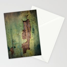 Old piece of wood painted green and peeling Stationery Cards