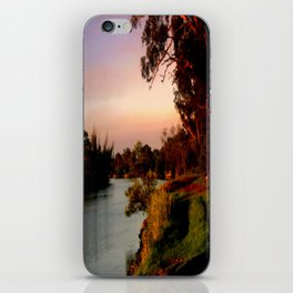 Reflecting sunset on the river Bank iPhone Skin