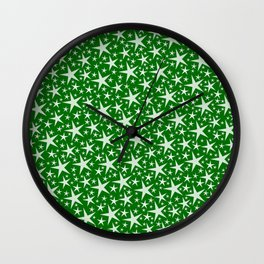 many small stars on festive paper background in green Wall Clock