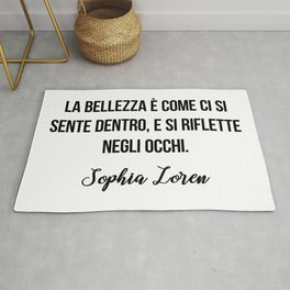 La bellezza è come ci si sente dentro, e si riflette negli occhi.   Sophia Loren Rug
