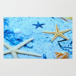 by the sea Rug