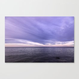 dramatic pink and purple sunrise over the ocean  Canvas Print